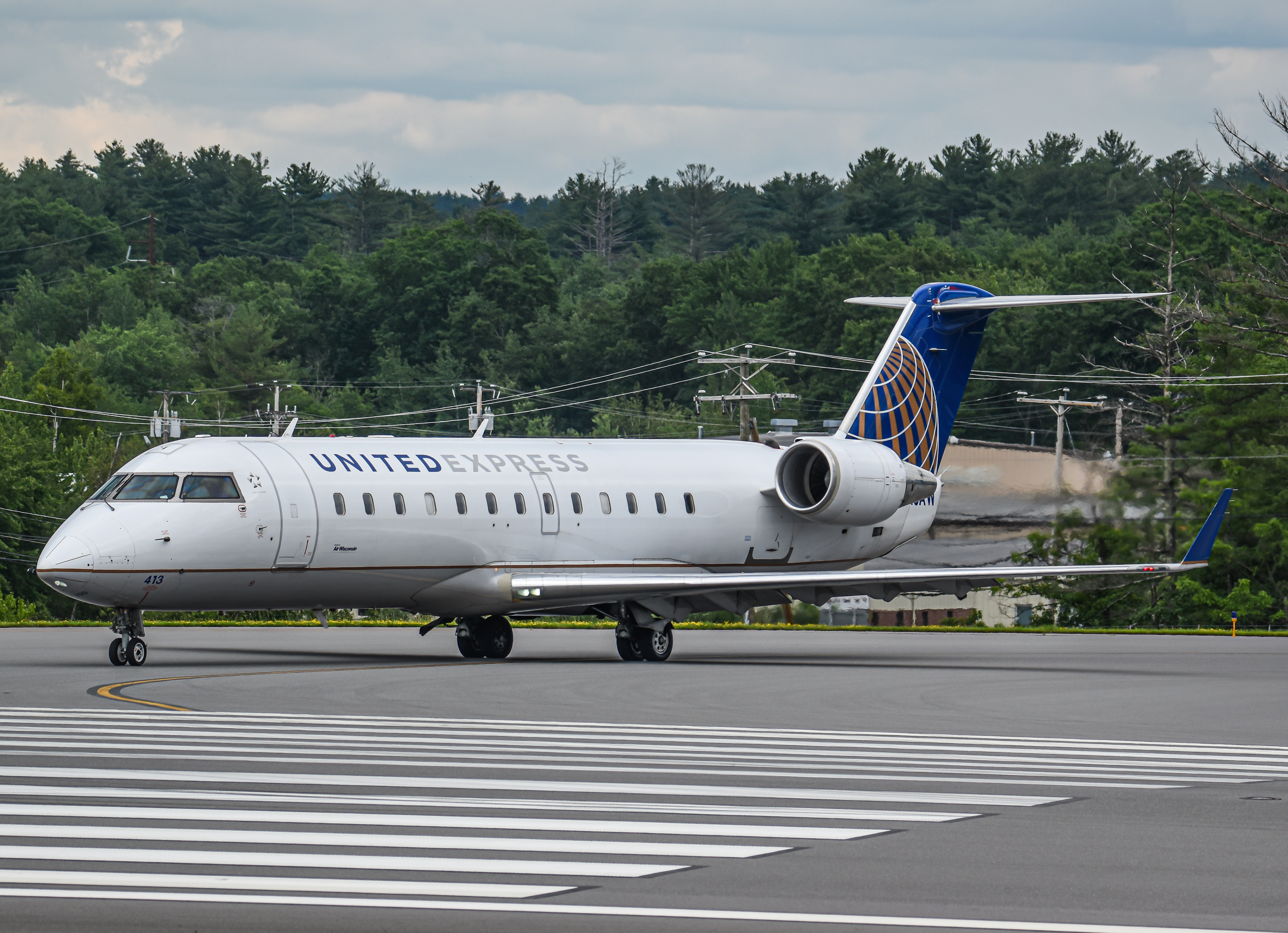 Photo of N413AW - United Express Mitsubishi CRJ-200 at MHT